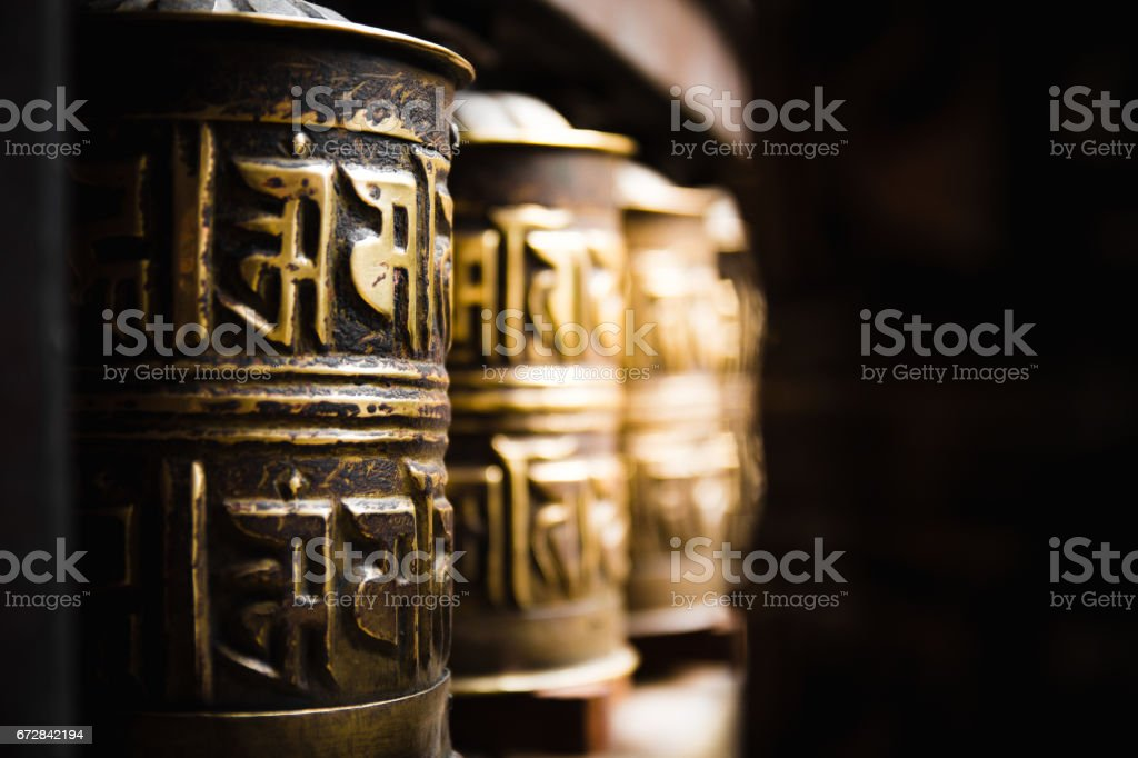 Golden prayer wheels at the golden temple in Patan, Nepal. stock photo