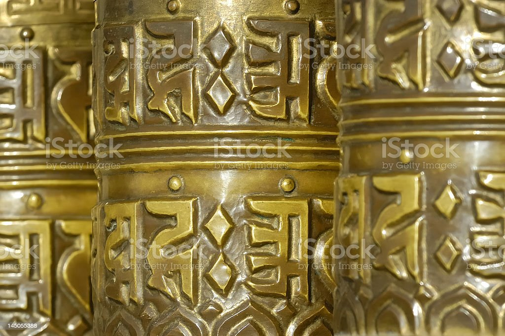 Golden prayer wheels stock photo