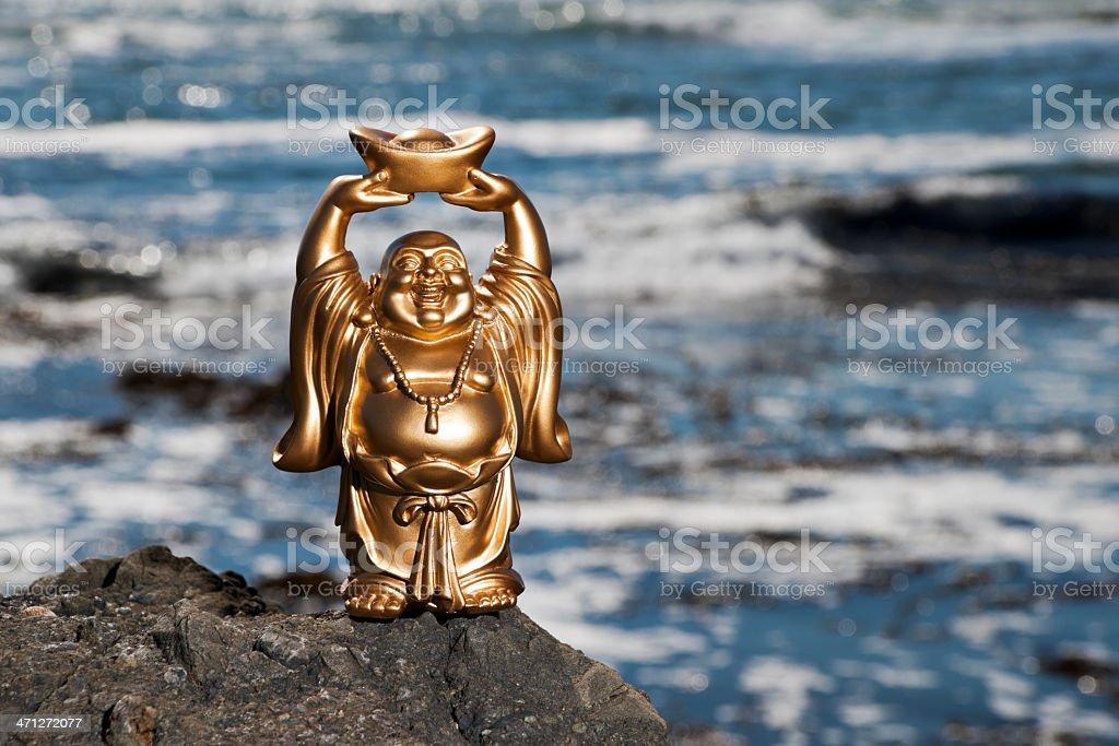 Golden Prosperity Buddha at Shoreline stock photo
