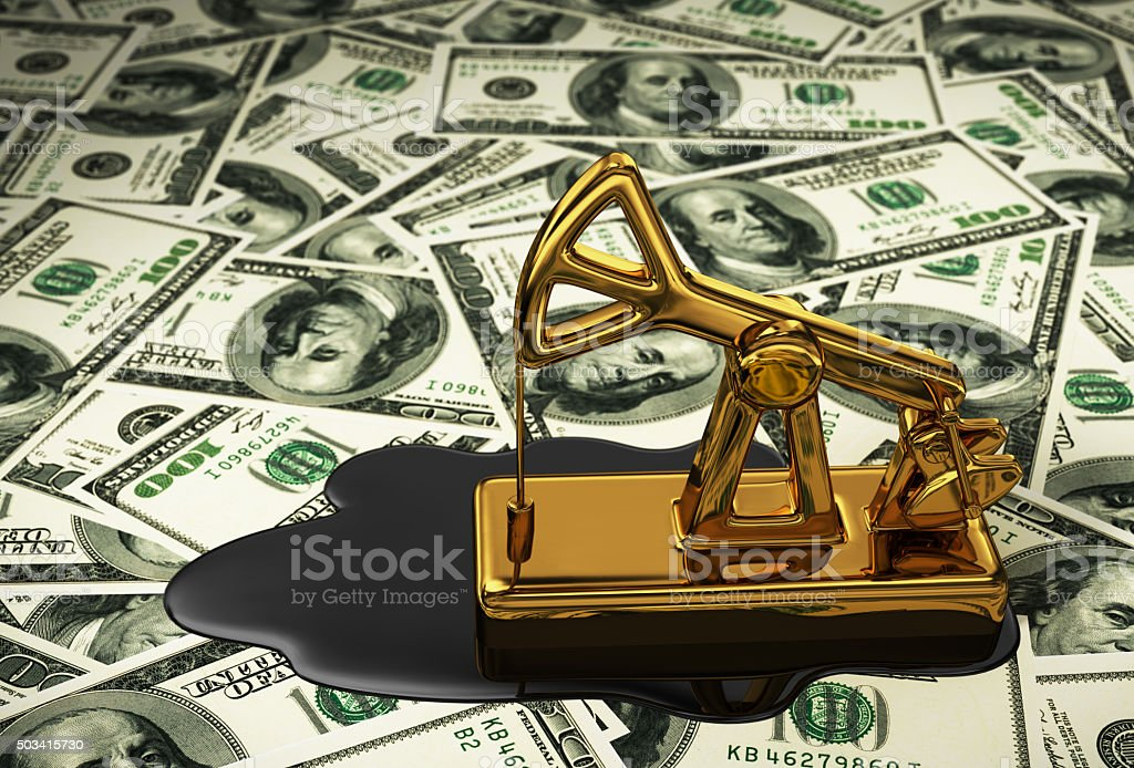 Golden Pumpjack And Spilled Oil On The Dollars stock photo