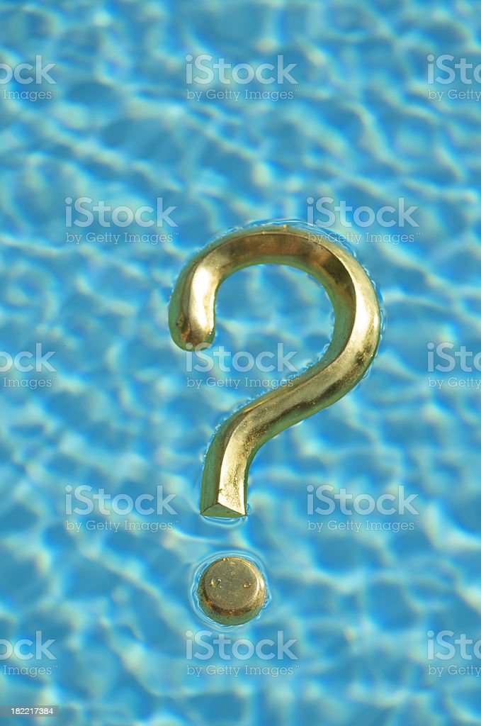 Golden Question Mark Floats in Blue Water royalty-free stock photo