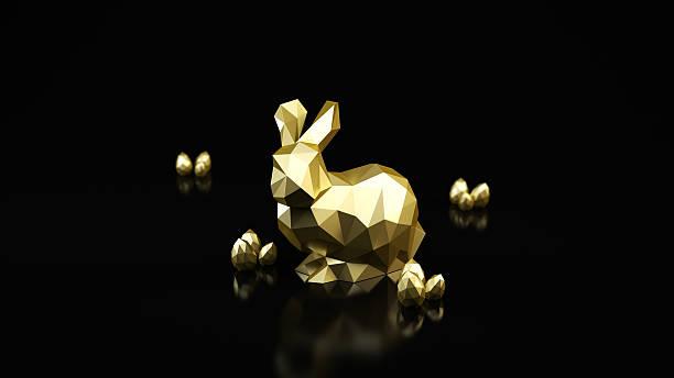 Golden Rabbit on dark background. stock photo