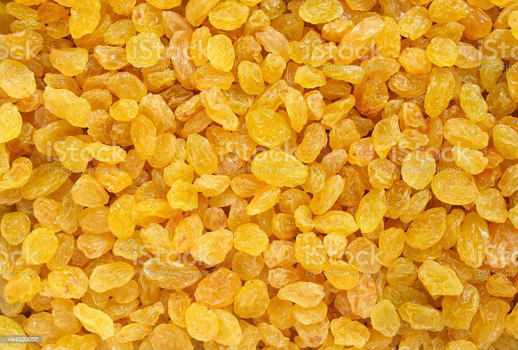 Golden raisins background stock photo
