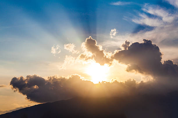 golden rays of the sun through the black clouds golden rays of the sun through the black clouds emergence stock pictures, royalty-free photos & images