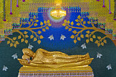 Golden reclining Buddha statue In the temple,Thailand.
