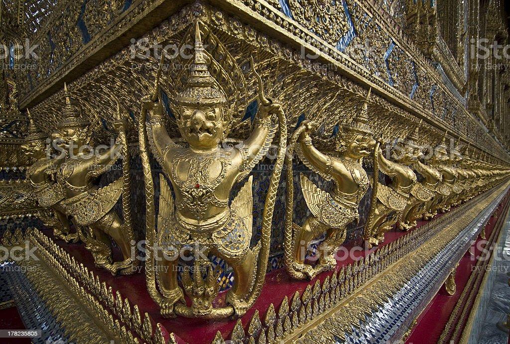 Golden Religon figures in The Royal Palace stock photo