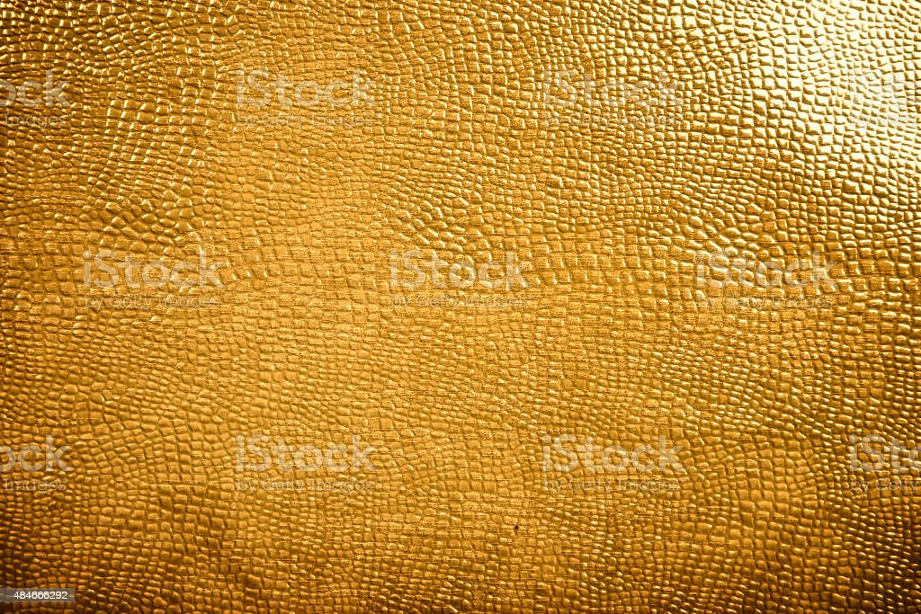 Golden reptile skin texture stock photo