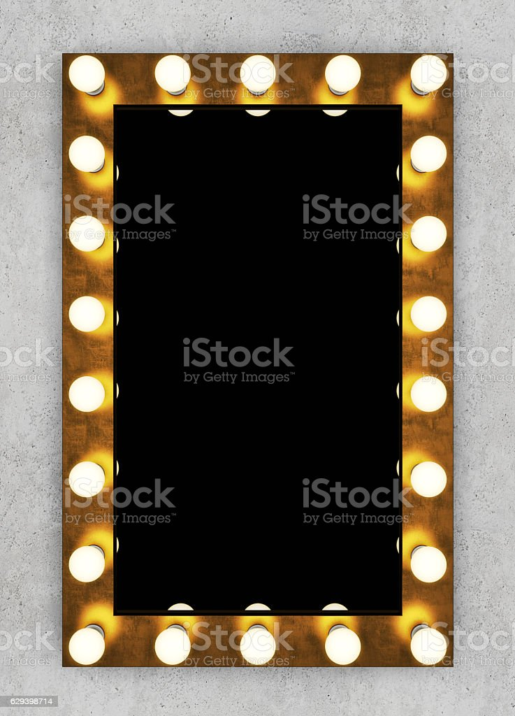 Golden retro makeup mirror on concrete wall stock photo