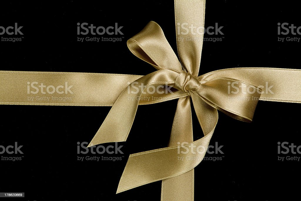 golden ribbon and bow stock photo