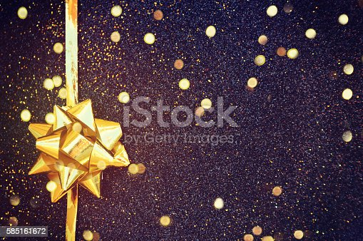istock Golden ribbon bow with bokeh,Christmas decoration 585161672