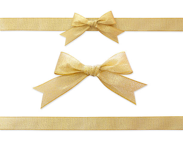 golden ribbon isolated on white - ribbon sewing item stock photos and pictures