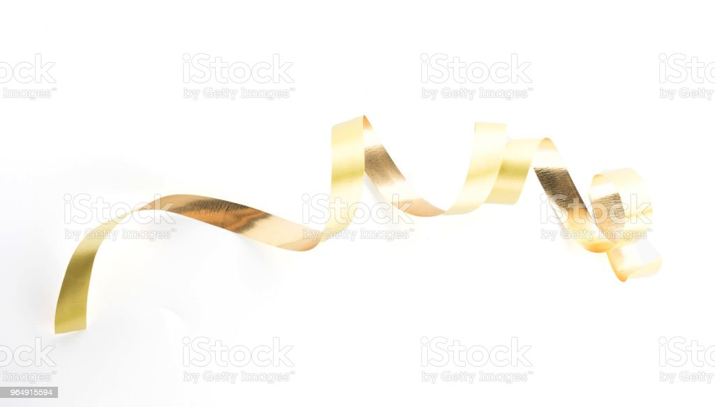 Golden ribbon roll isolated on white background royalty-free stock photo