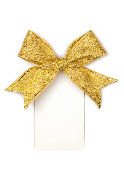 Golden ribbon with bow and card – Foto