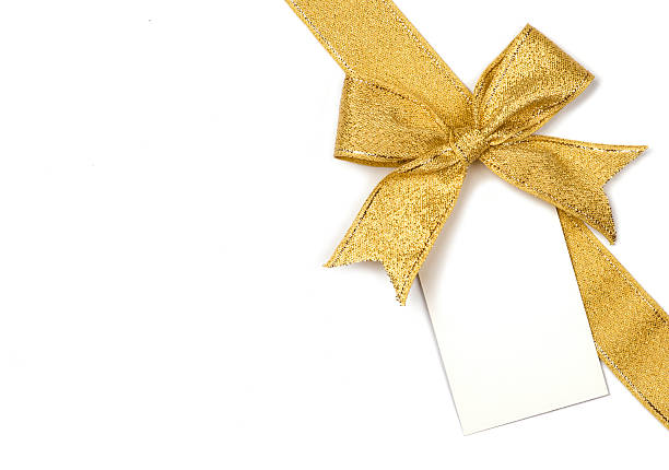golden ribbon with bow and card - gift tag note stock photos and pictures