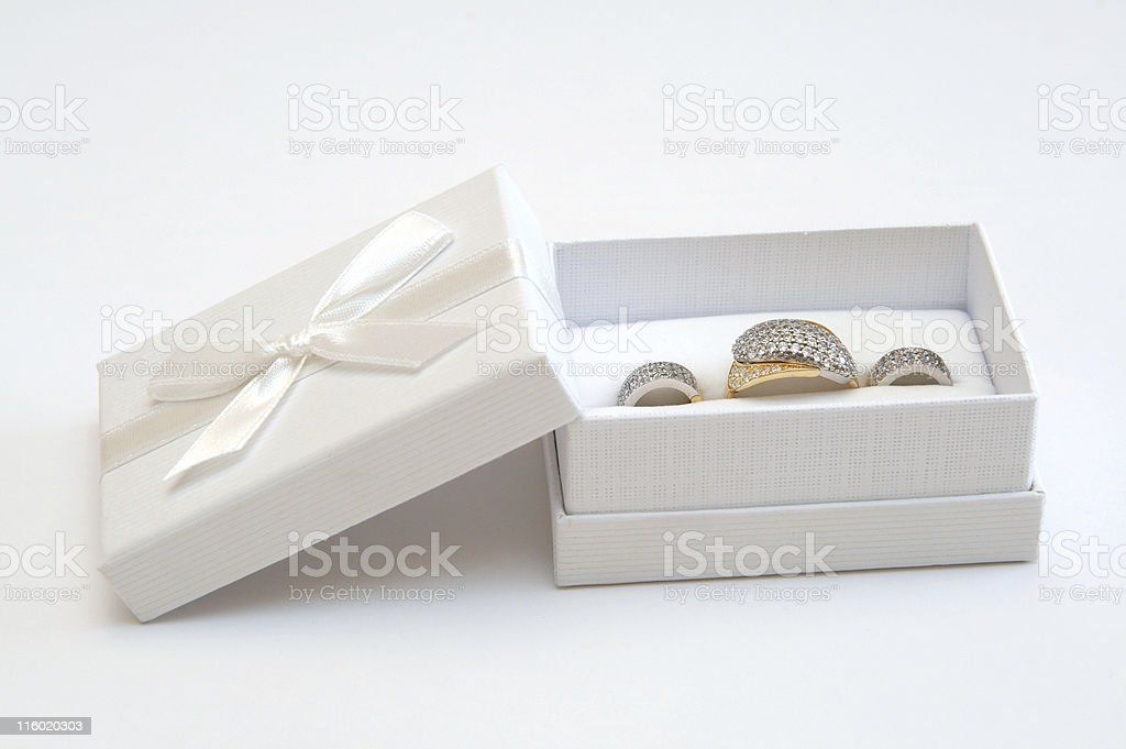 Golden ring and earrings royalty-free stock photo