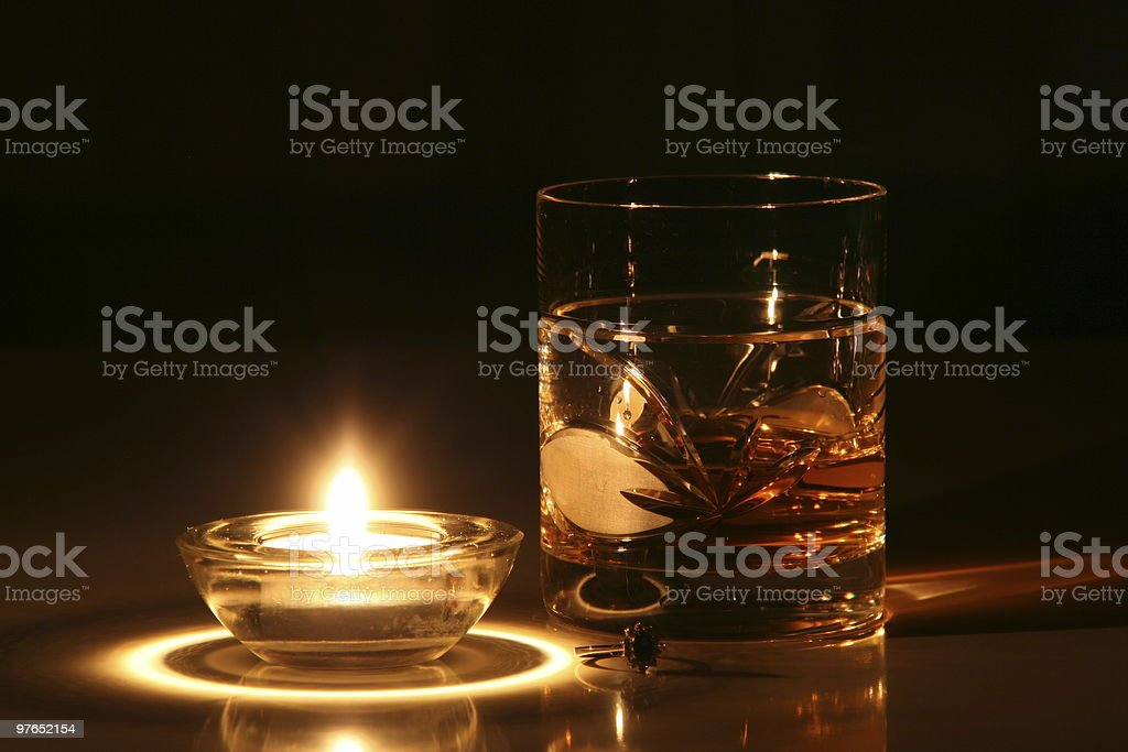 Golden ring and whisky glass stock photo