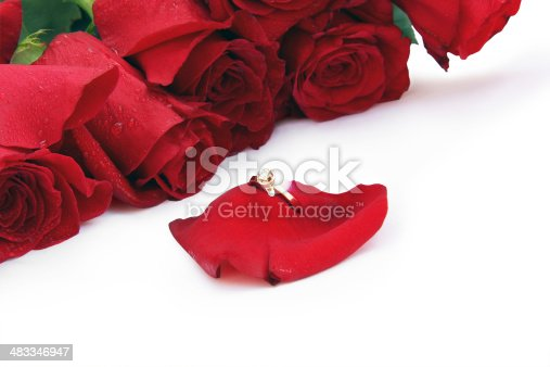 istock golden ring on a rose-petal round roses 483346947