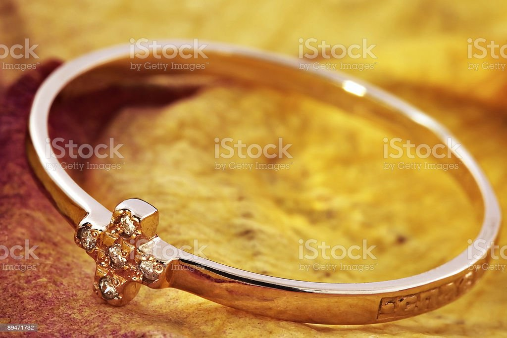 Golden ring with an ornament royalty-free stock photo