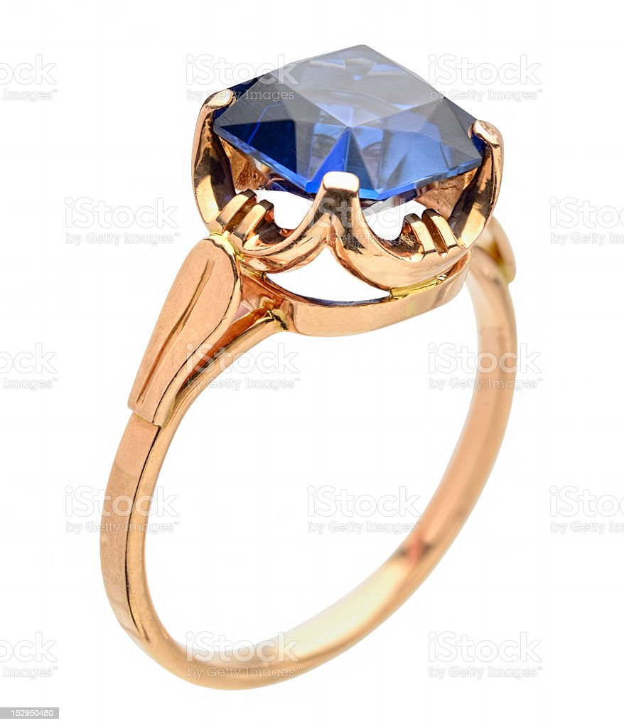 Golden ring with blue gem royalty-free stock photo