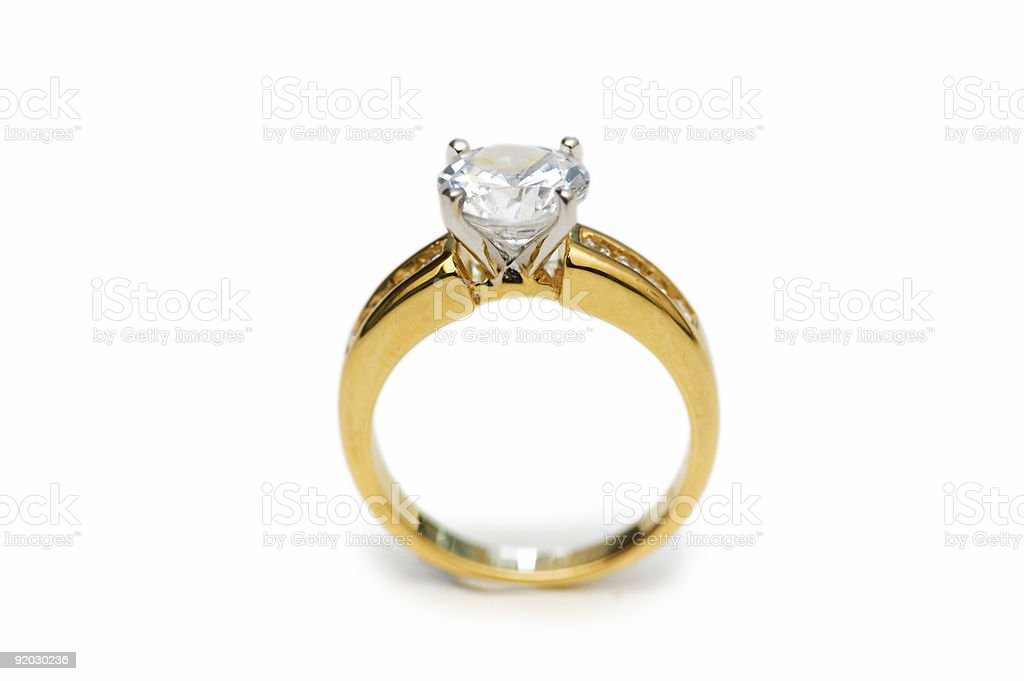 Golden ring with diamond isolated on the white stock photo