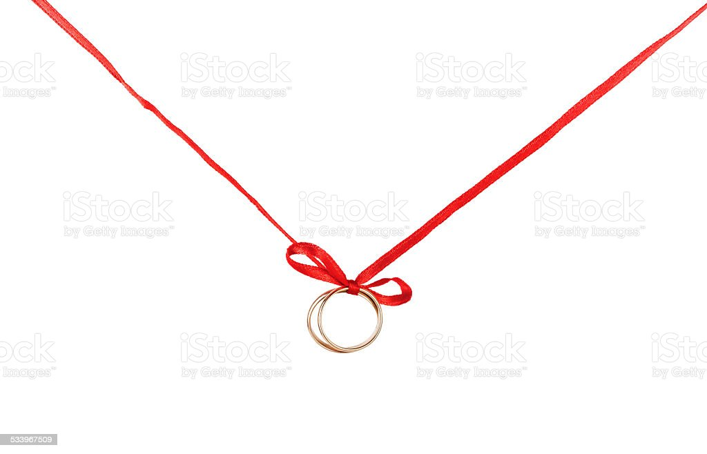 Golden rings on a red ribbon stock photo