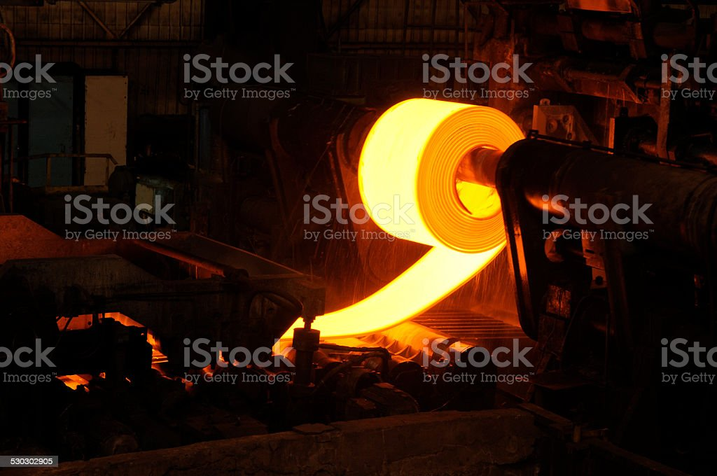 Golden Rolling Hot Steel in Steel Manufacturing Factory. stock photo