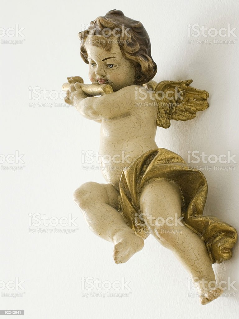 A golden roman angel isolated on a white background stock photo