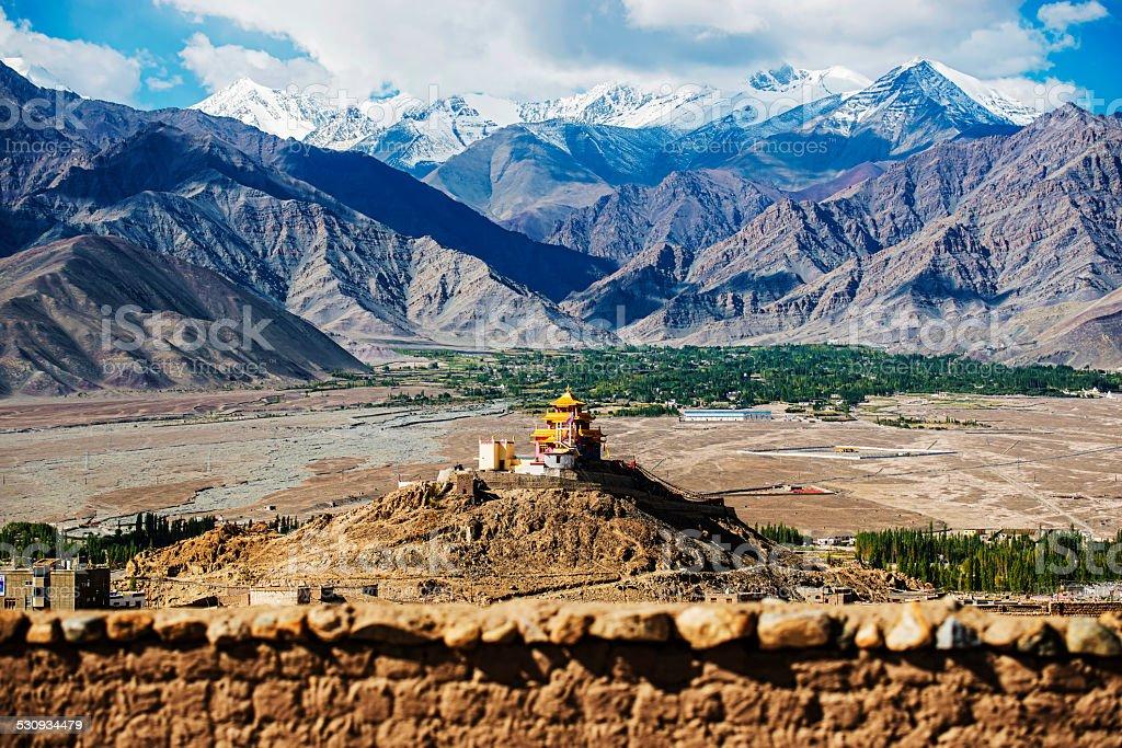 Golden roof monastery and snow mountain range stock photo