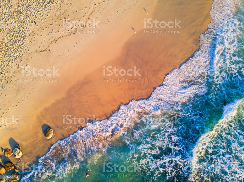 Golden sand and clear water stock photo