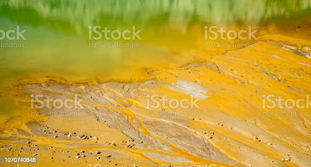 Photo of Golden sand dunes flowing into lake