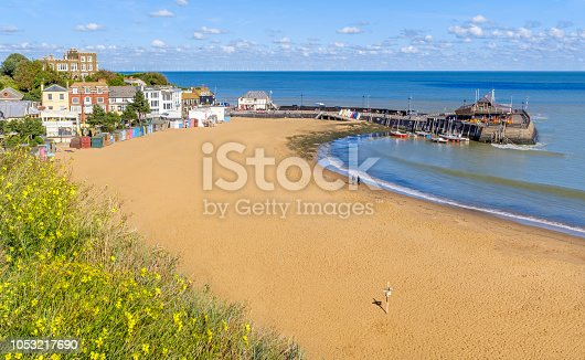 Golden sand of Viking Bay Broadstairs, Thanet, Kent, UK and the historic Bleak House on a sunny autumn day.