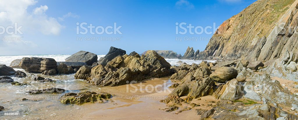 Golden sands, scogliere rocciose foto stock royalty-free