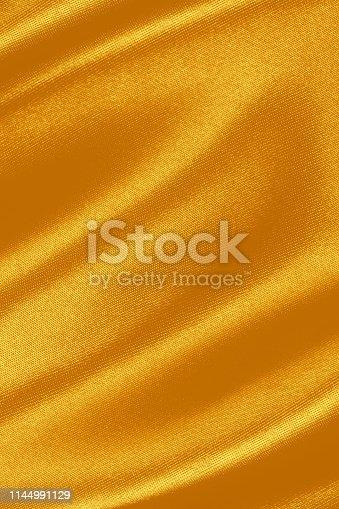 Golden satin background.