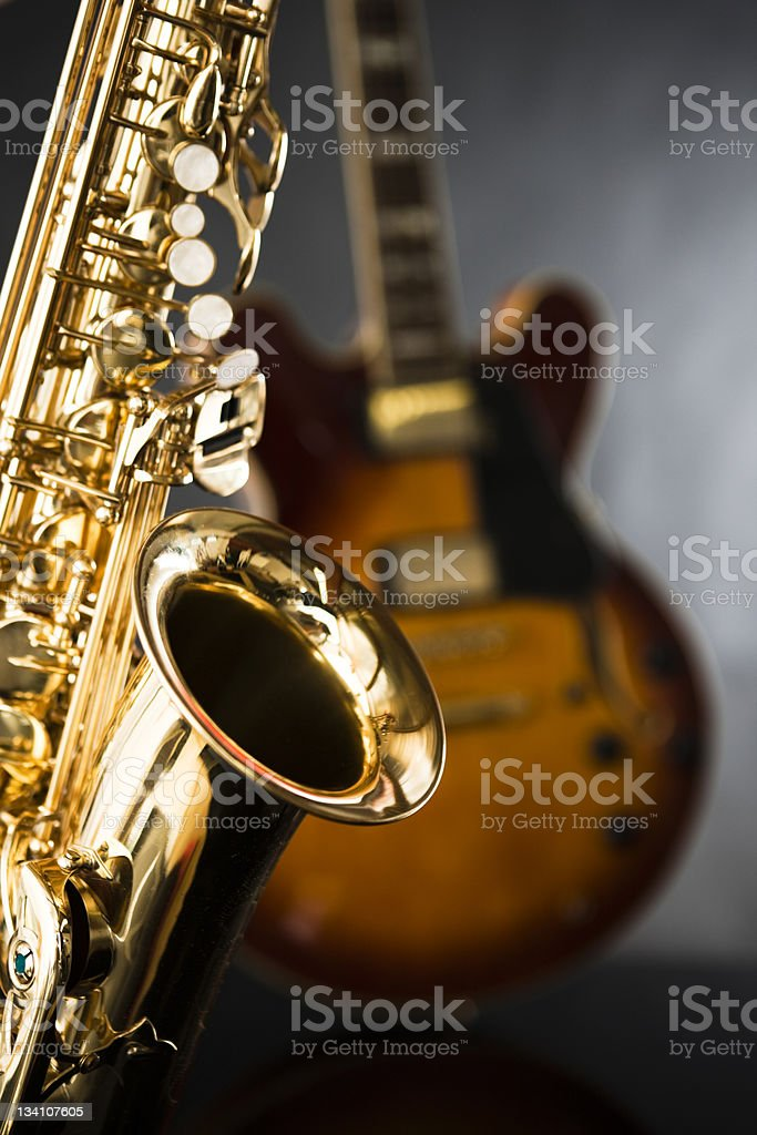 Golden sax and guitar ready for a jamming session stock photo