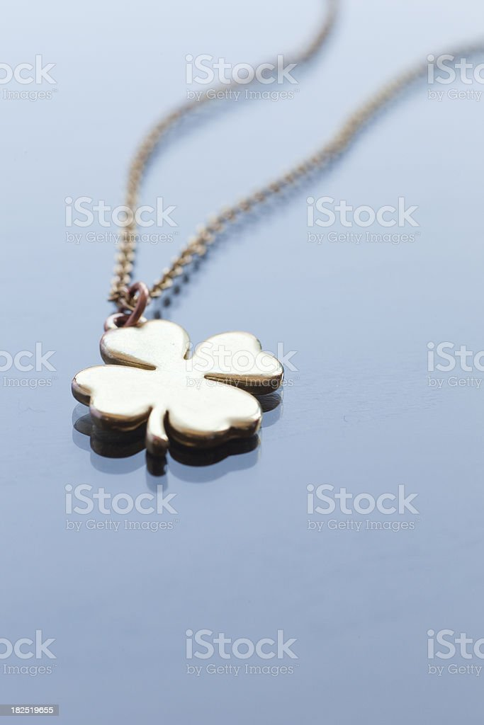Golden shamrock necklace royalty-free stock photo