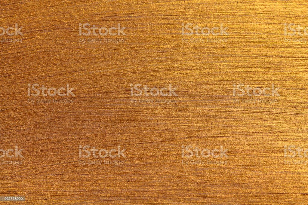 Golden shiny background. Bright golden background, sparkles and shines. A brush stroke - Royalty-free Abstract Stock Photo