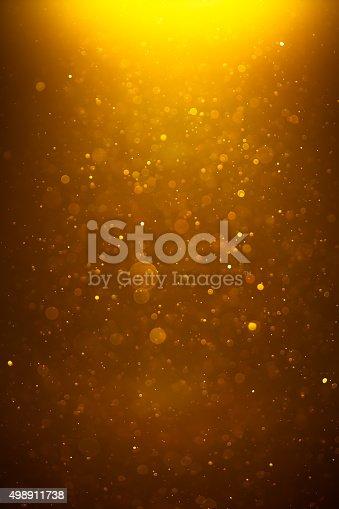 istock golden shiny bokeh background 498911738