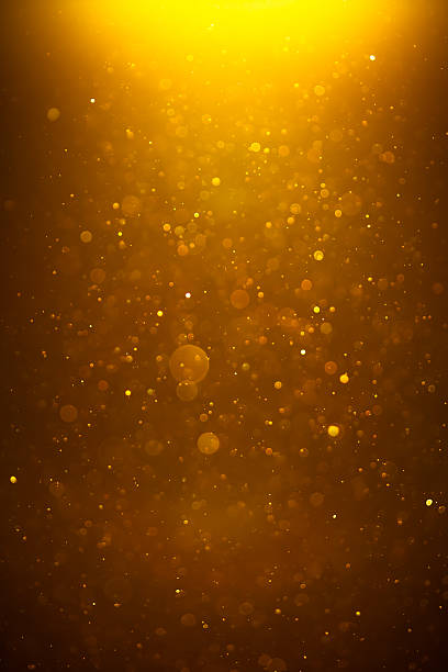 golden shiny bokeh background - light effect stock pictures, royalty-free photos & images
