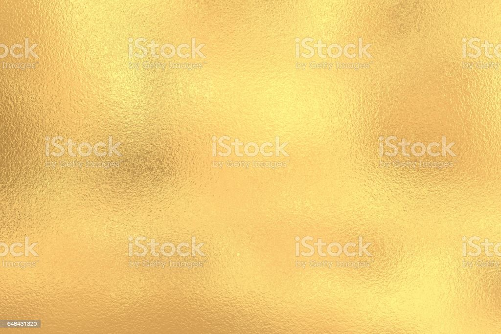 Golden shiny foil texture, gold background stock photo