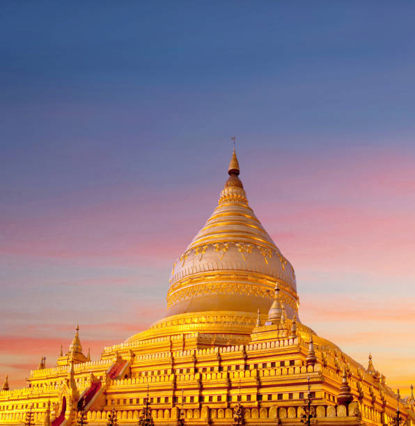 Golden Shwezigon Pagoda at sunset in Bagan, Mandalay Division, Myanmar stock photo