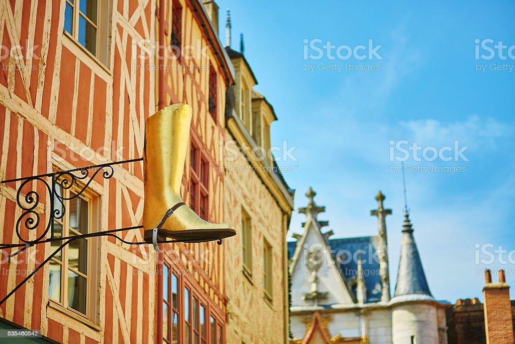 d'or panneau en forme de botte - Photo