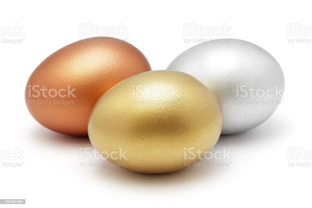 Golden silver and bronze eggs stock photo