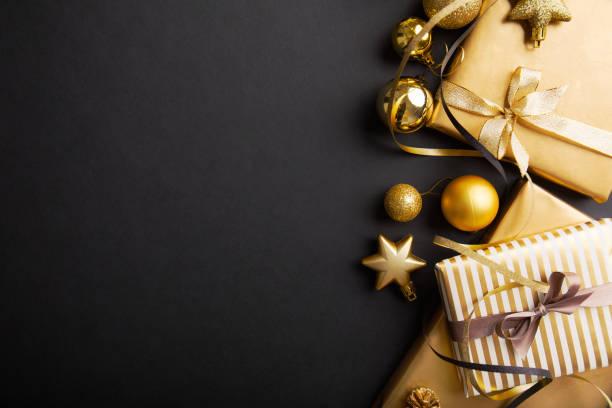 golden silver christmas deco on black - приглашение стоковые фото и изображения