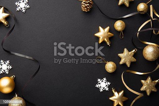 istock Golden silver christmas deco on black 1059655558