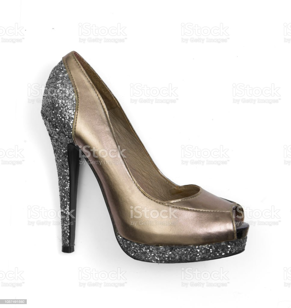 fb780880fbe Golden silver glitter high heel peeptoe shoe isolated on white background -  Stock image .