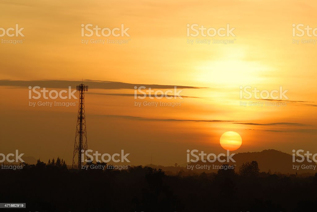 golden sky with telecommunication tower royalty-free stock photo
