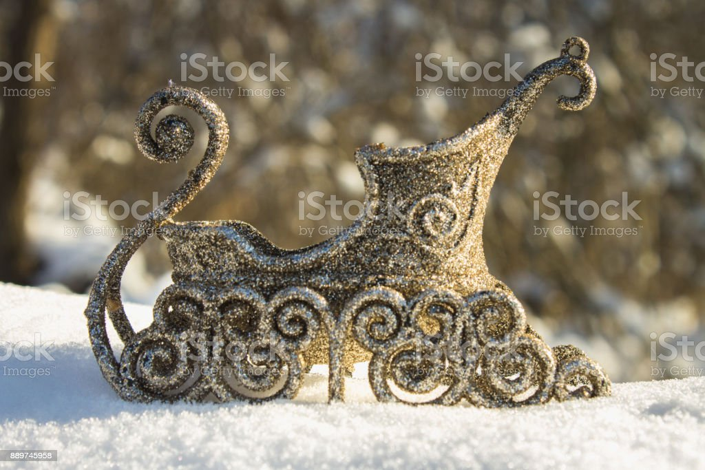 Golden sleigh in the snow. Christmas toys. stock photo