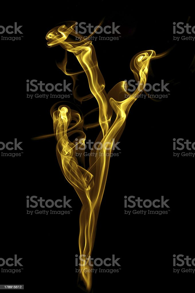 Golden smoke of rose isolated on black background royalty-free stock photo