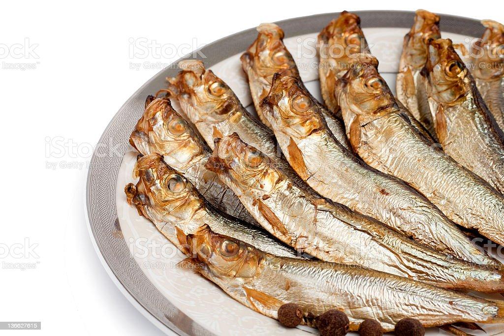 Golden smoke-dried fish stock photo