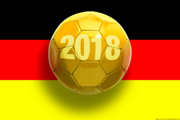 Golden soccer ball on flags background. stock photo